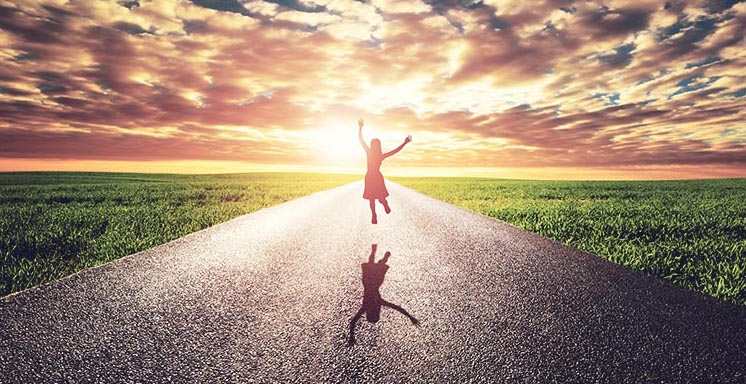 woman jumping in air embracing courage to change