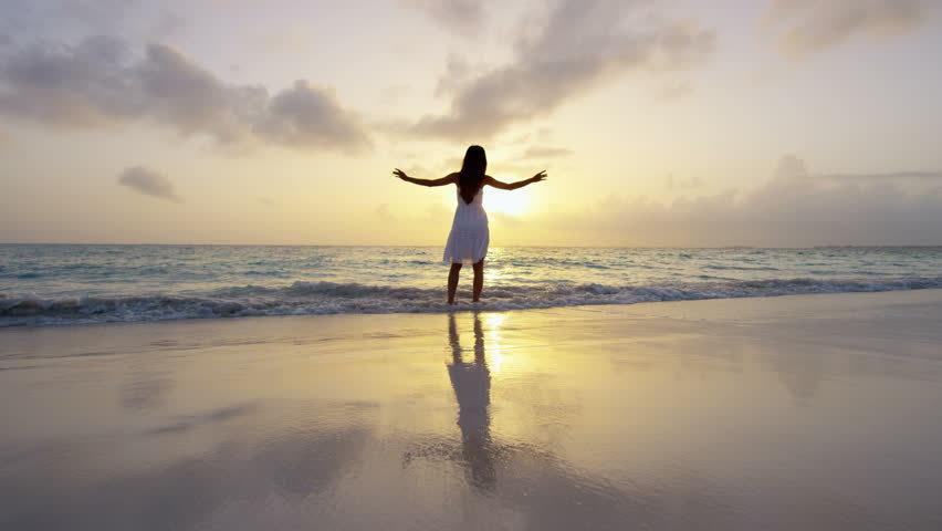 woman at beach resolving spiritual disconnect