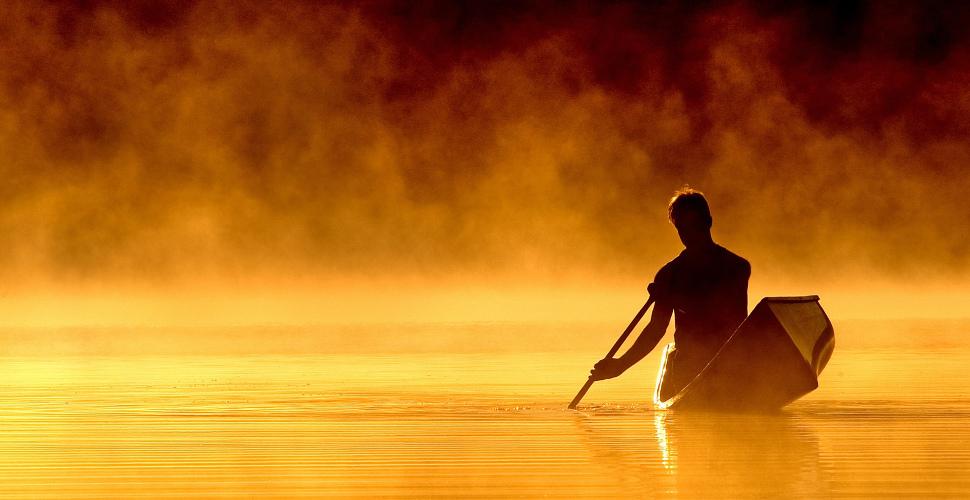 man in rowboat navigating life journey
