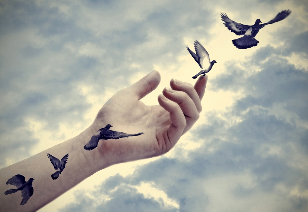 extended arm releasing negativity and birds