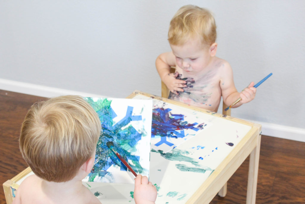 Your toddler will love this great snowflake stencil painting craft!