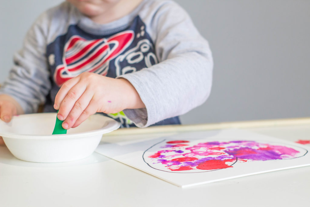 A wonderful Valentine's Day toddler craft - clothespin painting!