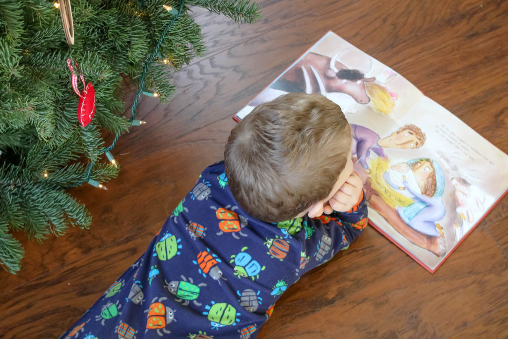 Are you looking for children's books about the true meaning of Christmas? This post has the best children's nativity books, children's books about Christmas tradition, and children's books about the real St. Nicholas. Your kids will want to read these Christmas books all season long!