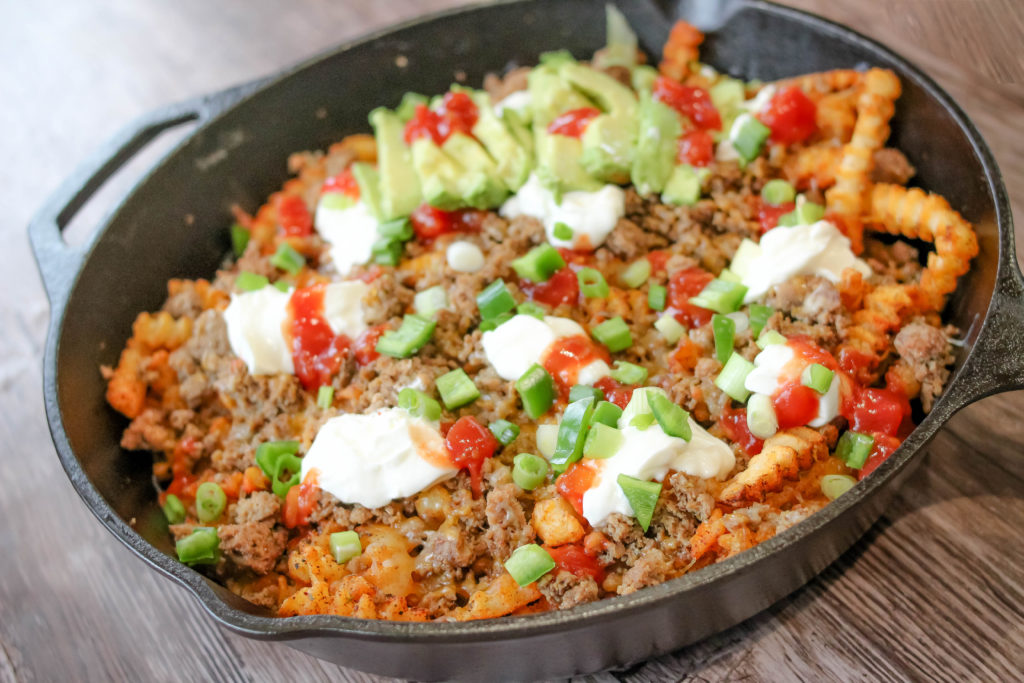 The very best loaded Mexican fries recipe! You're not going to want to miss out on making these skillet loaded fries!