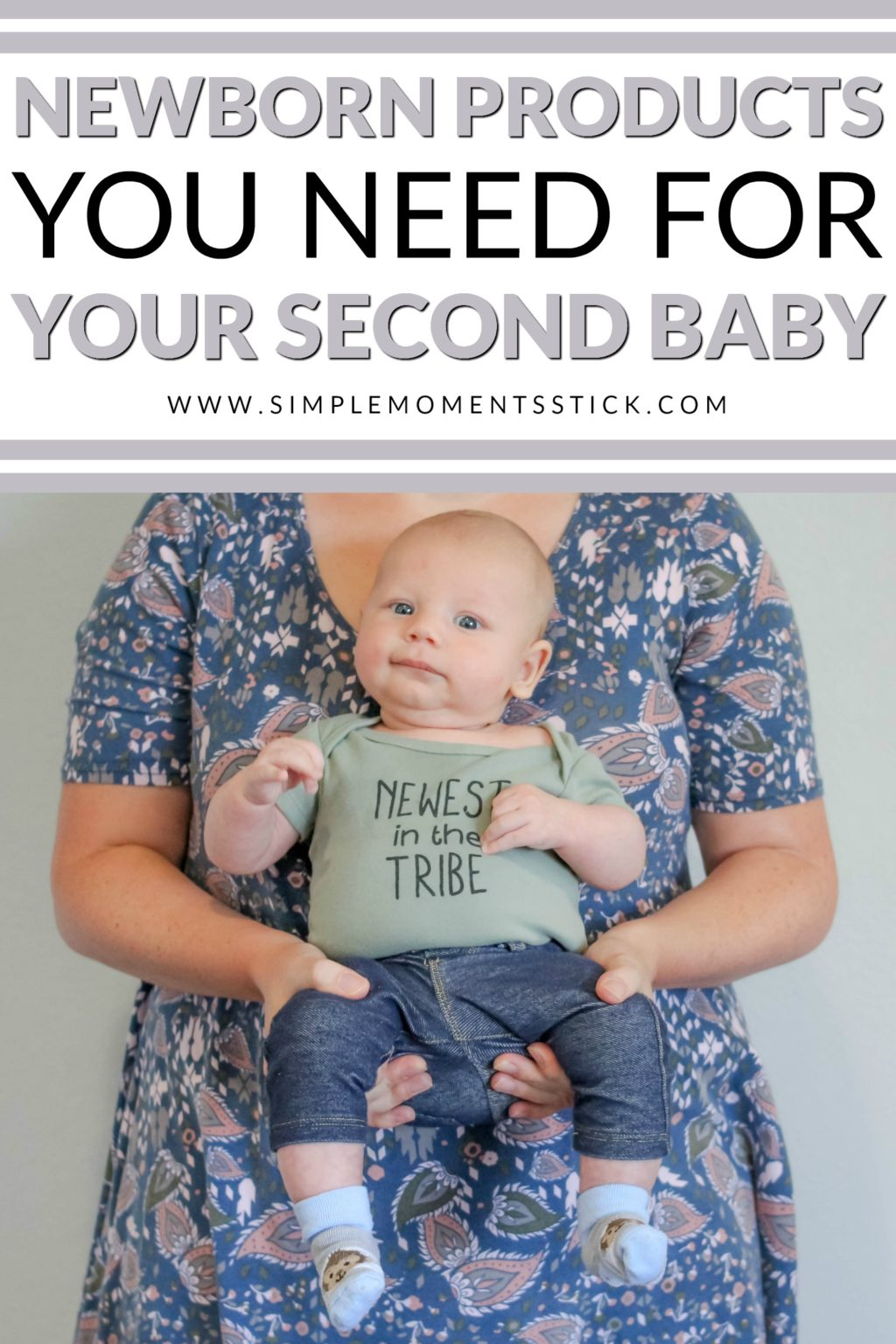 Woman holding baby boy with onesie that says Newest in the Tribe with text saying - Newborn Products You Need For Your Second Baby