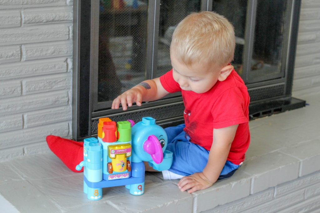 Toddler boy playing with LeapBuilders elephant