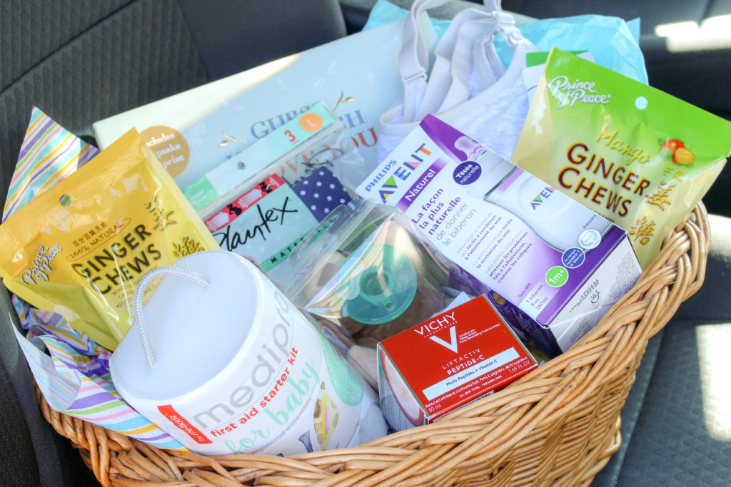 Basket full of baby items sitting in front seat of car