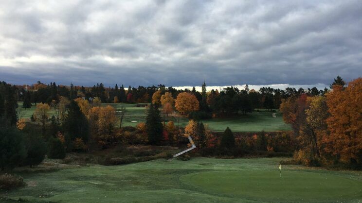 Nice fall colours looking back to the difficult second shot landing area on the 18th fairway.  The green is small and tricky too!