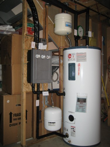 Hot Water Tank attached to solar panels on the roof