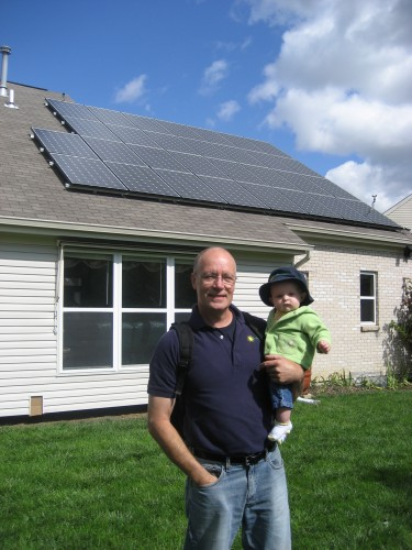 Carl Adams and his daughter admiring the PV system at the Marcus Residence