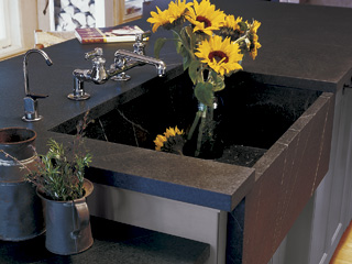 Sunflowers in a handcrafted Vermont Soapstone custom deep sink.
