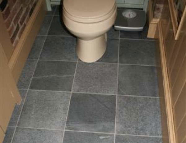 Vermont Soapstone manufactured and installed the flooring system in this lavatory.