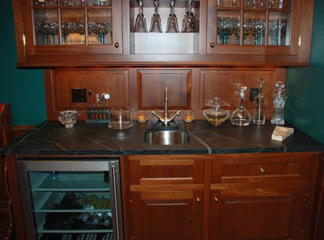Vermont Soapstone is ideal for a bar top, because acids, such as lemon and lime juice, won't etch the surface like marble or granite.