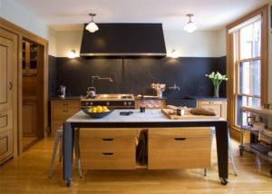Modern restaurant style kitchen with expansive Vermont soapstone backsplash
