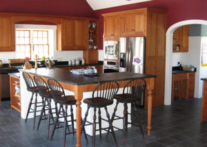 A Vermont Soapstone floor is light blue-gray with subtle veining.