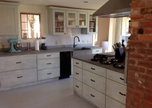 Vermont Soapstone is the classic choice for this stunning farmhouse kitchen.