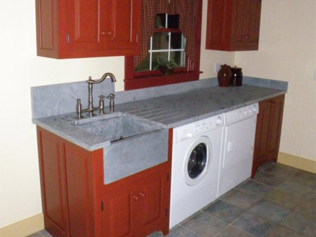 Vermont Soapstone countertop and deep sink make this a laundry room you'll like to spend time in.