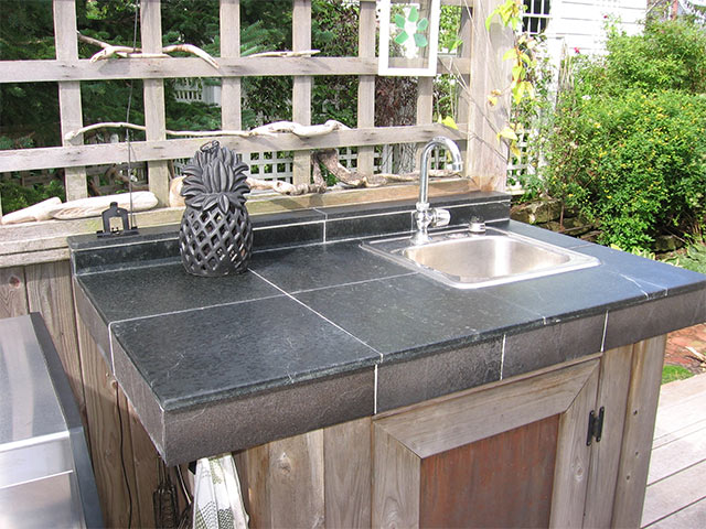 Outdoor kitchen with Vermont Soapstone tile countertop