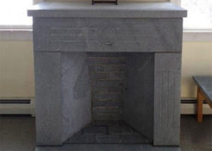 Soapstone can be used to build a a handsome free-standing fireplace with slabs and fire bricks.