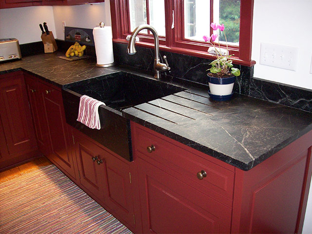 Vermont Soapstone makes stunning custom kitchen counters and apron front sinks.