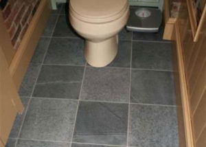 Bathroom designed with Vermont Soapstone tile flooring.
