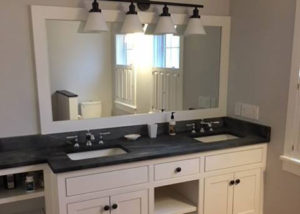Vermont Soapstone counter and backsplash with inset porcelain sinks.