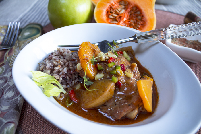 """A """"smothered"""" stew rich with vegetables,  apples and chicken that falls-off-the-bone"""