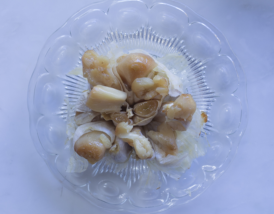 The roasted garlic cloves squeezed from two heads