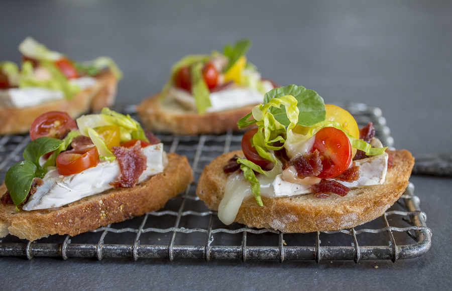 Crisp garlicky toasts piled with oozing brie cheese, bacon, lettuce and tomato.