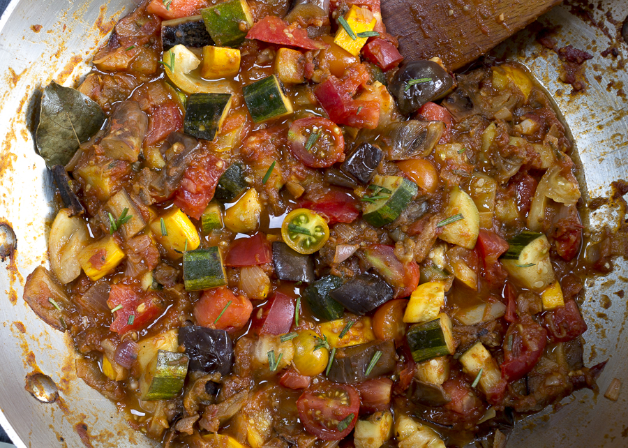Add tomatoes and seasonings and stew together