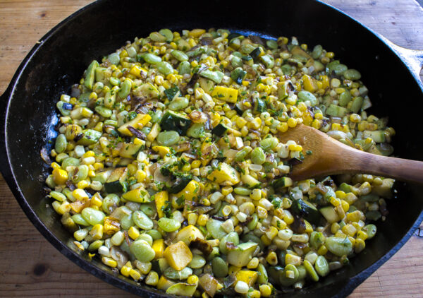 Skillet Succotash with fresh corn, lima beans, butter beans, (optional) multi-colored zucchini, caramelized shallots and a touch of jalapeño.