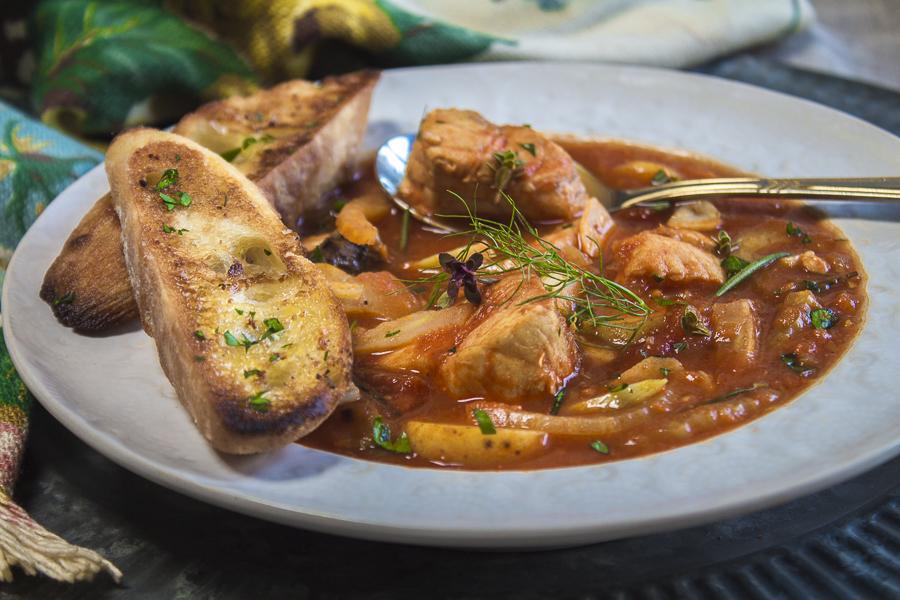 Lots of mingling flavors - fennel, saffron, garlic and orange. A healthy fisherman's stew