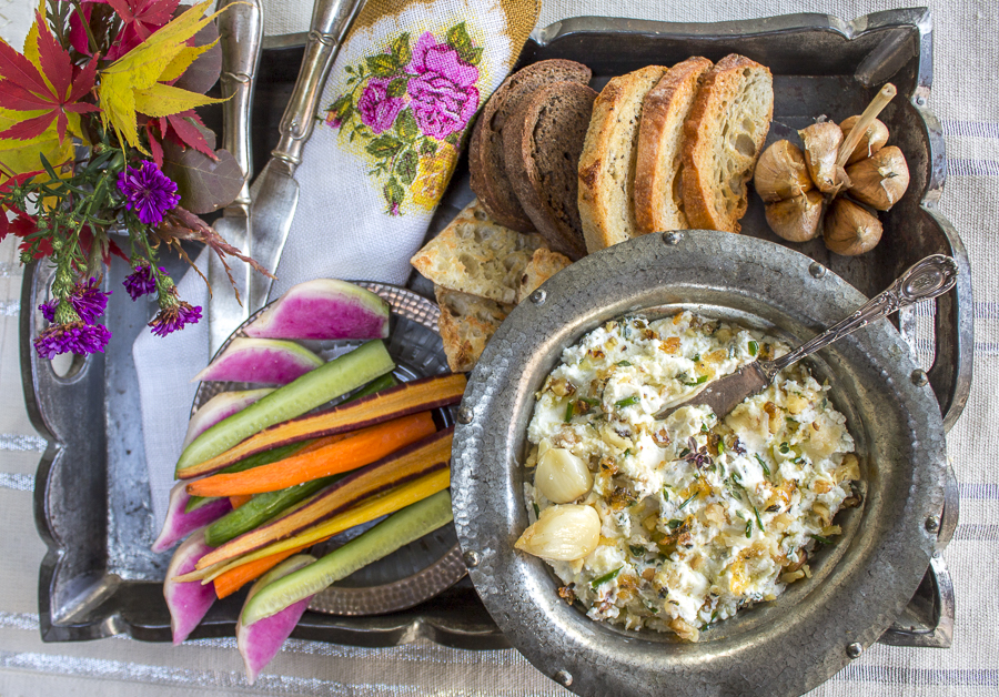 Perfect for any party, toast up your favorite bread, and add some crudite - serve extra roasted garlic cloves on the platter