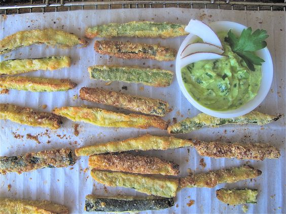 Oven baked and delicious zucchini fries with a crispy coating of shredded coconut, corn meal and gluten-free flour.