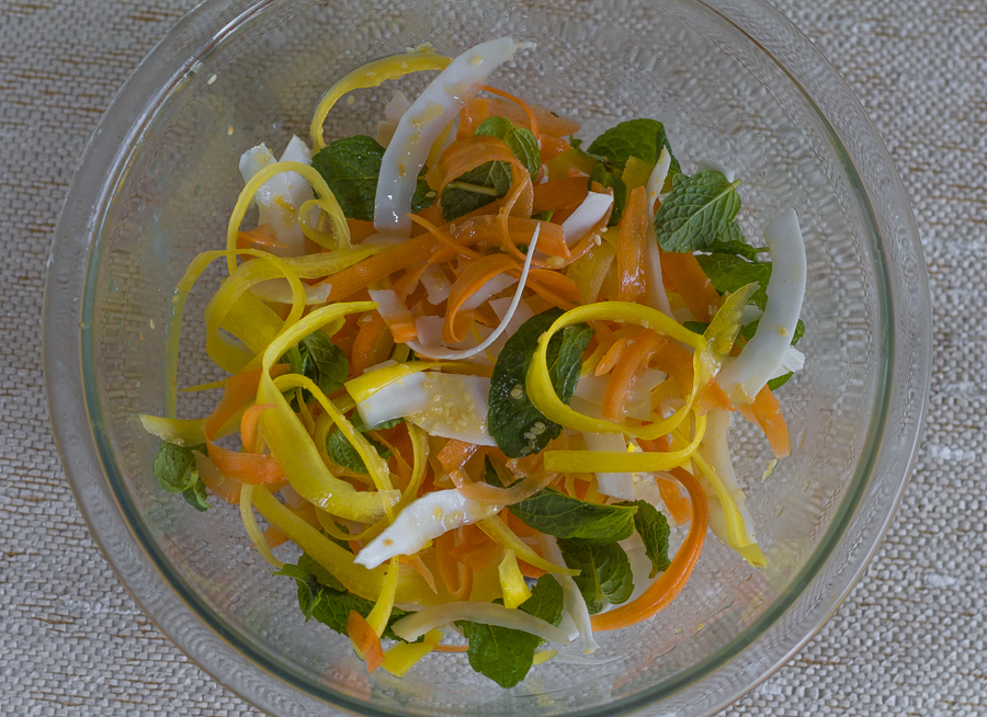 shaved carrots combine with coconut, beets and mint leaves with a Sesame-Ginger Dressing