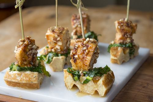 The Ultimate Appetizer with Southern Charm ~ Grilled Chicken with Pecans and a Maple-Bourbon Glaze on top of crisp Buttermilk Waffles and Sweet and Sour Sautéed Collard Greens