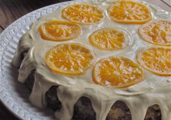 "Simple ingredients transform into a moist and heavenly orange-almond flourless cake. Reminiscent of a Sicilian recipe, Mediterranean ingredients, using Marcona Almonds and Clementine Oranges from Spain. Inspired by movie: ""The Secret Lives of Walter Mitty."""