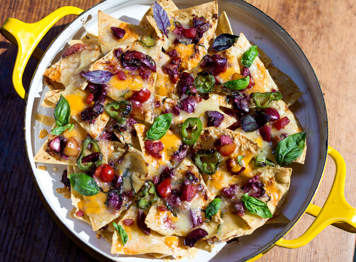 Fresh Cherry Salsa over layered Nachos in a vintage pan