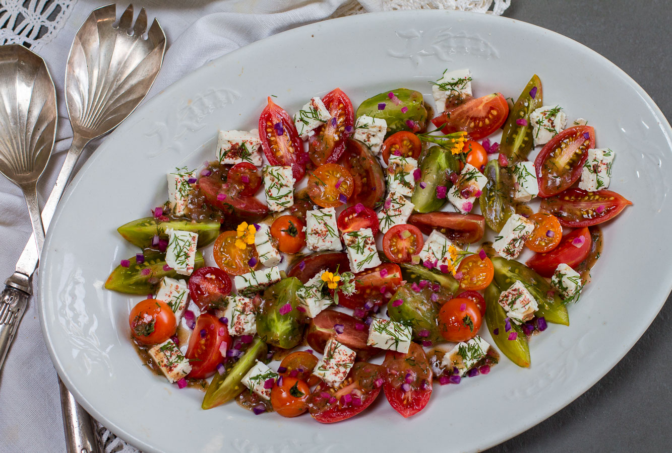 Heirloom Tomatoes ~ Bite-Sized, Team up with Creamy French Feta Cubes with a Zesty Vinaigrette for a Simple Summer Salad