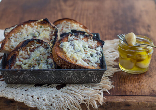 This Garlic Toast takes garlic bread to a new level! Sourdough Bread gains flavor from the outdoor grill - kissed twice with garlic... Garlic Confit Oil and Softened Garlic Confit Cloves