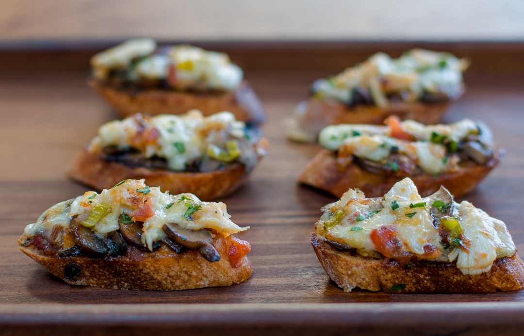 A few bites of heaven ~ this Spanish tapas recipe has authentic Spanish flavors with sautéed sliced cremini mushrooms, a smoked paprika aioli (garlic mayonnaise) and topped with Spanish Mahón cheese