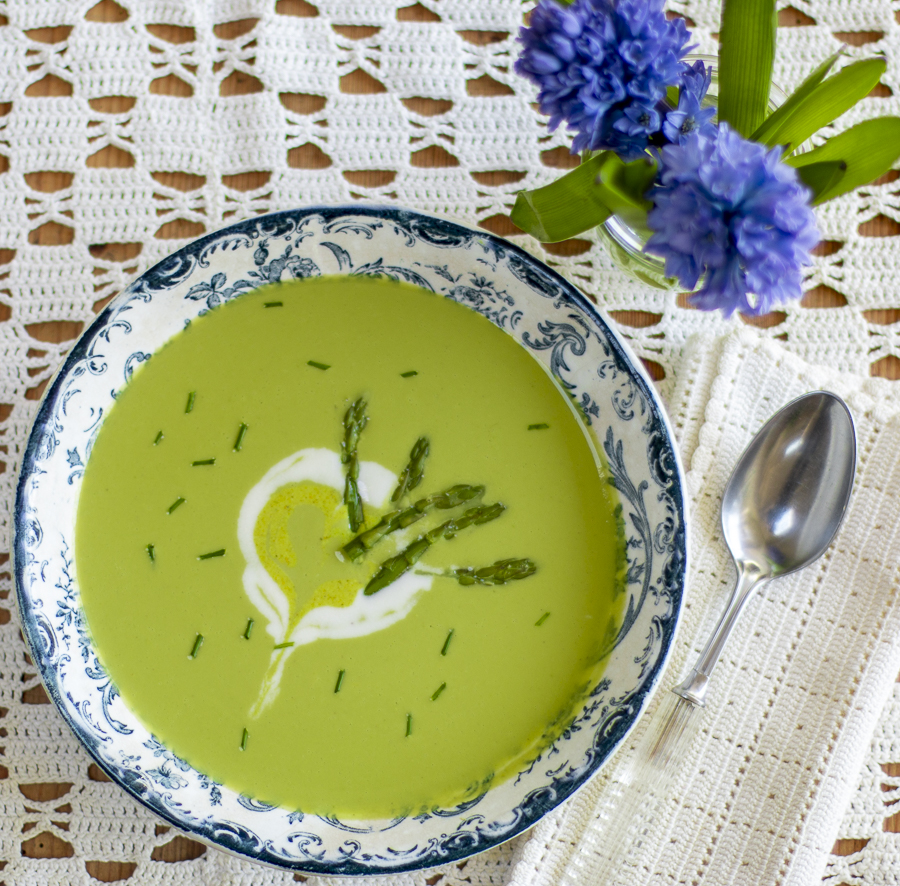 Spring Asparagus Soup – Vegan – with Cashew Crema Swirl in a vintage blue & white bowl