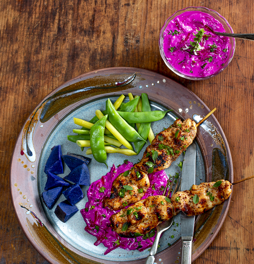 Beet Tzatziki with Spiced Chicken Skewers on a vintage plate