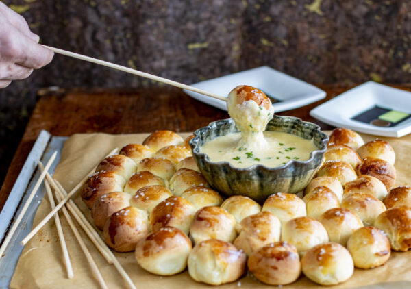 Swiss fondue done right with the addition of mellow garlic and chives. For the total experience serve with my Master Dinner Rolls with Flaky Salt