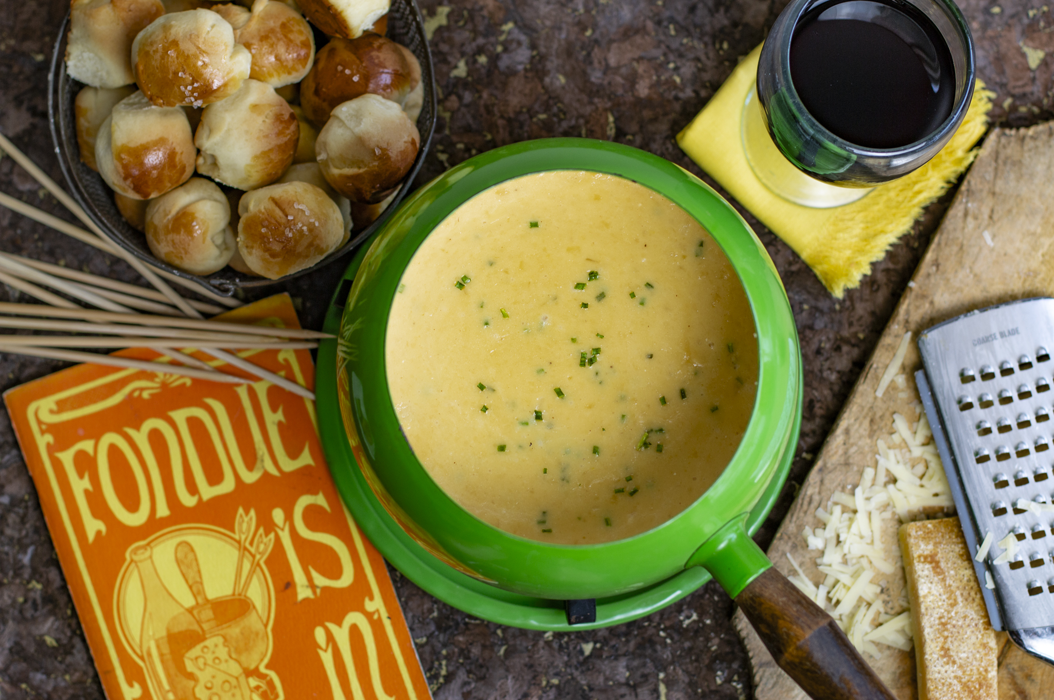 Swiss fondue done right with the addition of garlic and chives. Serve with my amazing Mini Dinner Rolls with Flaky Salt!