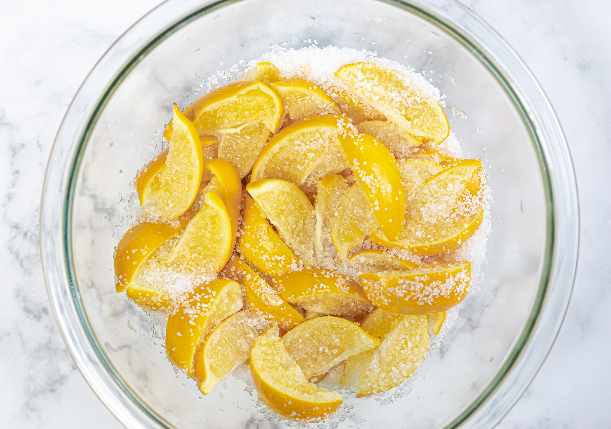 Kosher coarse salt is rubbed into the lemon wedges