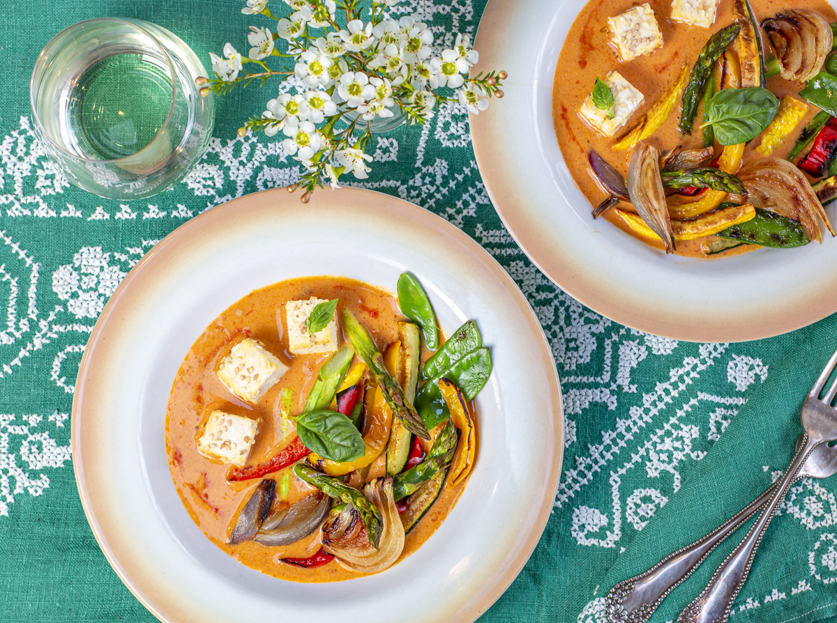 Red Coconut Curry with Sesame Tofu & Roasted Vegetables in vintage bowl on aqua vintage linen