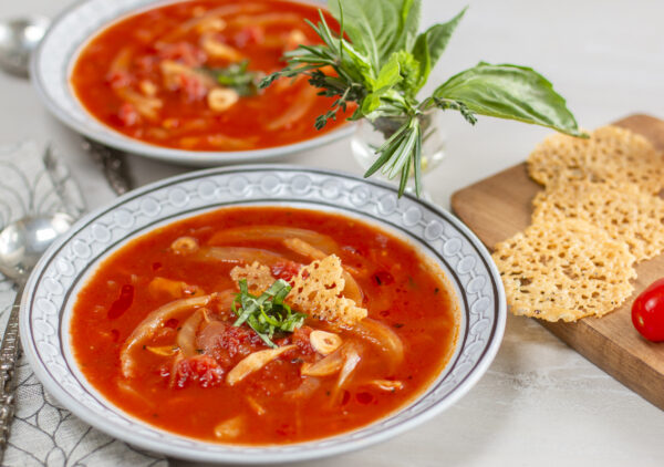 Herbed Tomato and Fennel Soup with Parmesan Crisps in mid-century bowls