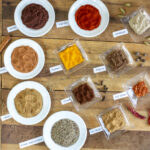 11 spices for Iraqi Seasoning Spice Blend on a vintage board