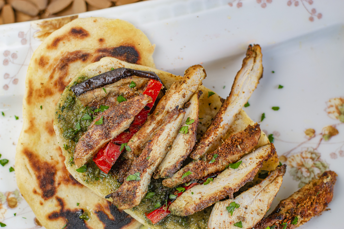 Sliced Iraqi Chicken on Homemade Naan Bread with Iraqi Pesto